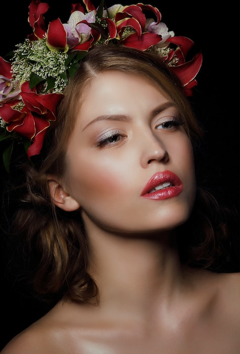 A retouched portrait image of a woman with flowers in her hair