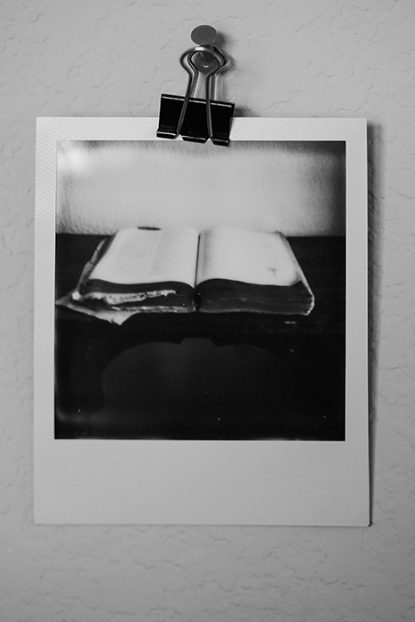 A black and white Polaroid picture of a book