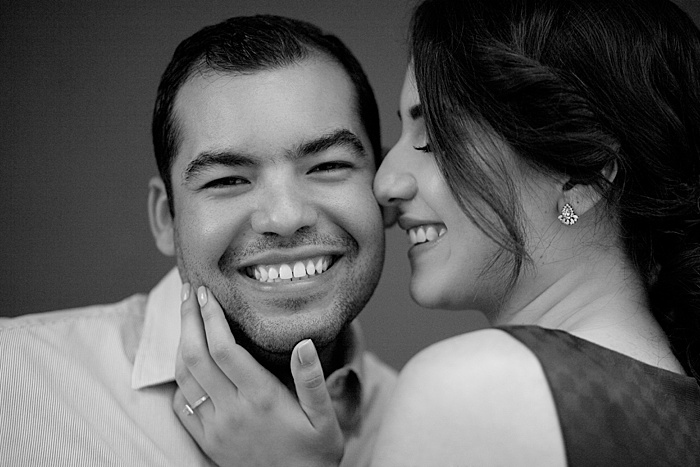 Close up black and white portrait of a couple smiling