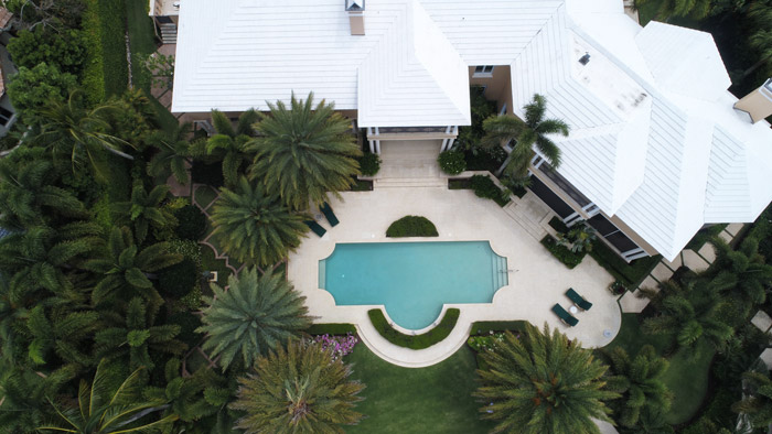 Drone photo of a house with a pool