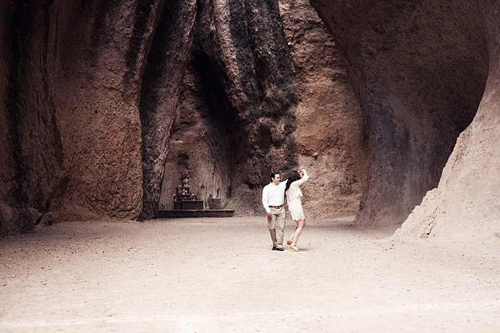 a romantic portrait of a couple dancing in a cave
