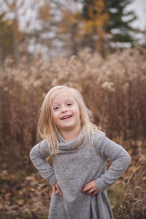 Photo of a girl posing on a field