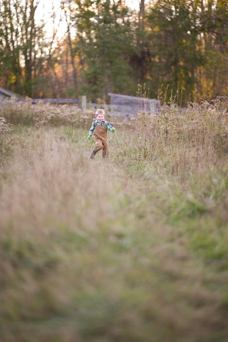 Photo of a little boy running on a field