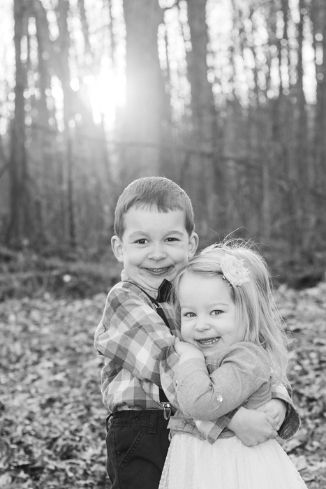 Black and white photo of kids hugging each other