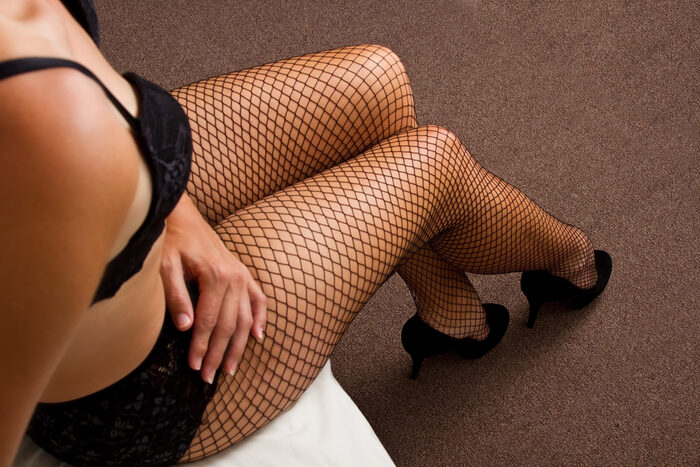 Boudoir photo of a woman in fishnet stockings