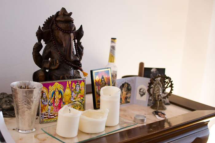 a still life featuring spiritual icons and candles