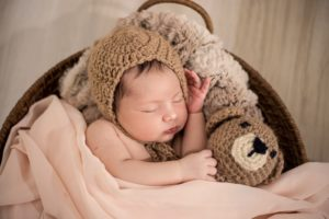 DIY newborn photography of a newborn with a teddybear