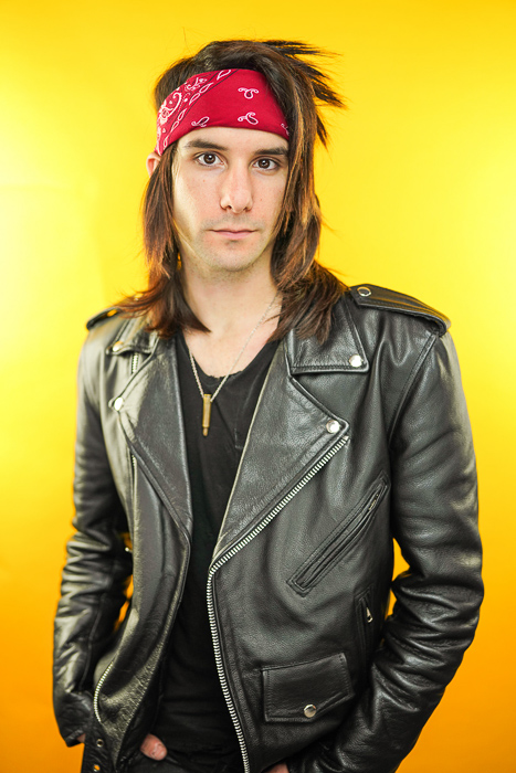 Portrait photo of a man in a leather jacket shot using paramount lighting