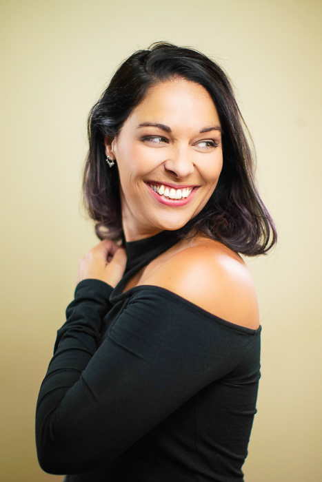 Portrait photo of a woman with neutral background