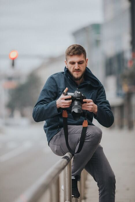 Photo of a photographer with a camera