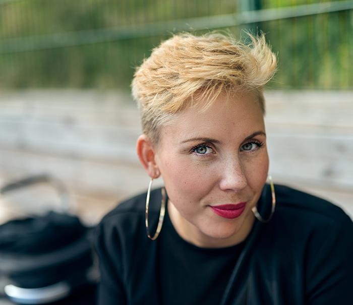 a professional headshot photo of a stylish young woman
