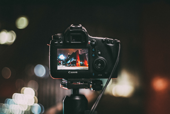 A canon camera on a tripod