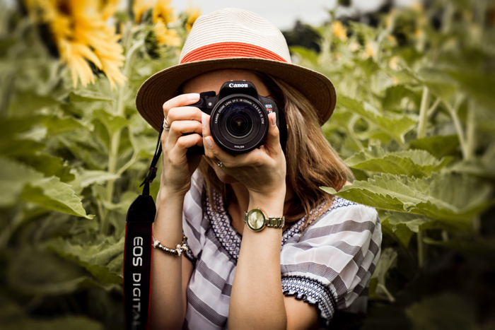A girl taking a photo with a Canon camera