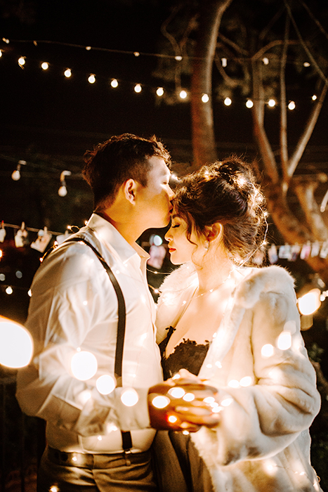 night wedding portrait using fairy lights as wedding photography props