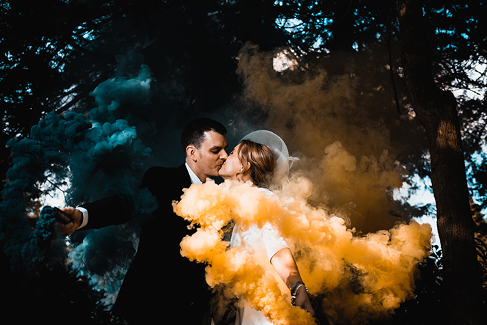 A couple posing with smoke bombs
