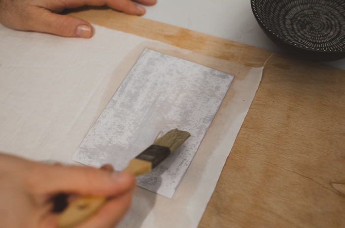 Applying water on paper with a brsuh