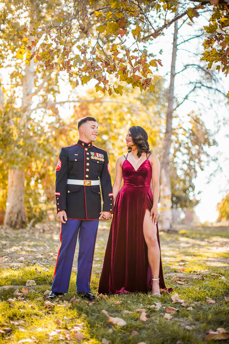 Portrait photo of a couple posing outdoors