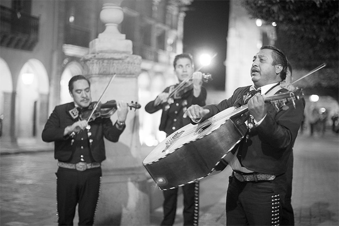 Black and white street portrait of a Mariachi band