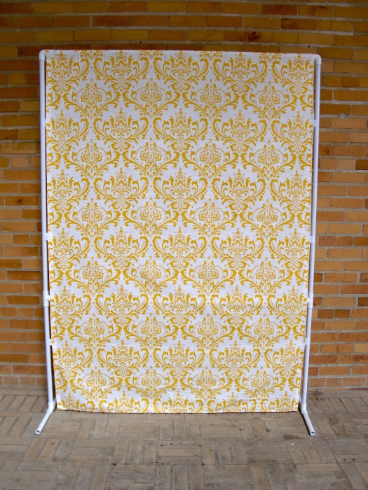 A DIY backdrop stand with patterned backdrop fabric