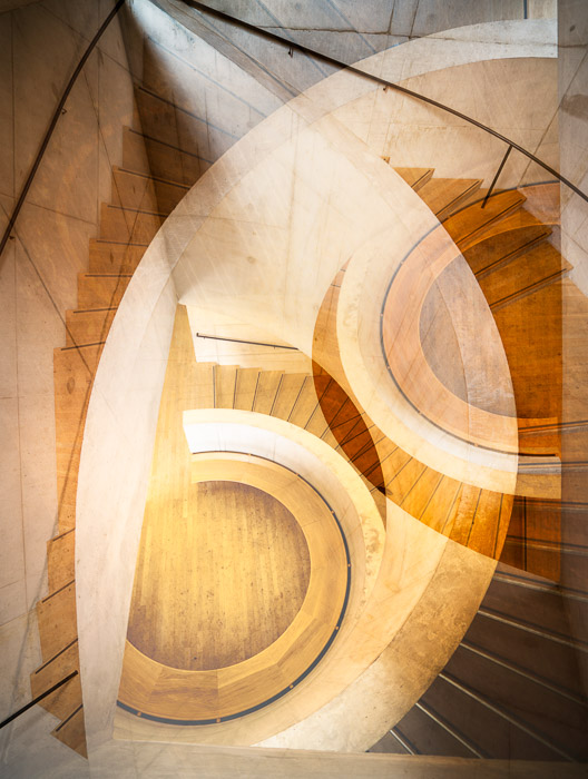 Fine art photography of two layered photos of the same staircase taken from different angles.