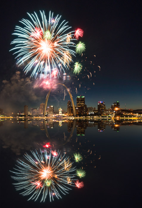 Photo of fireworks reflecting on a waterscape