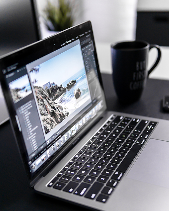 Photo of a laptop and a mug