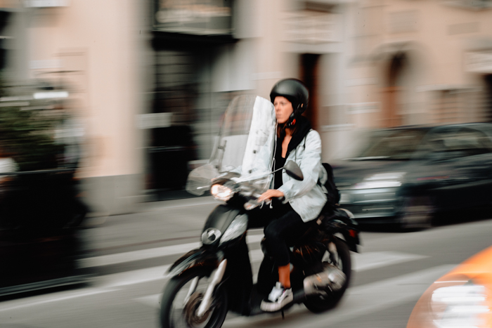 Photo of a girl on a motorbike with motion blur