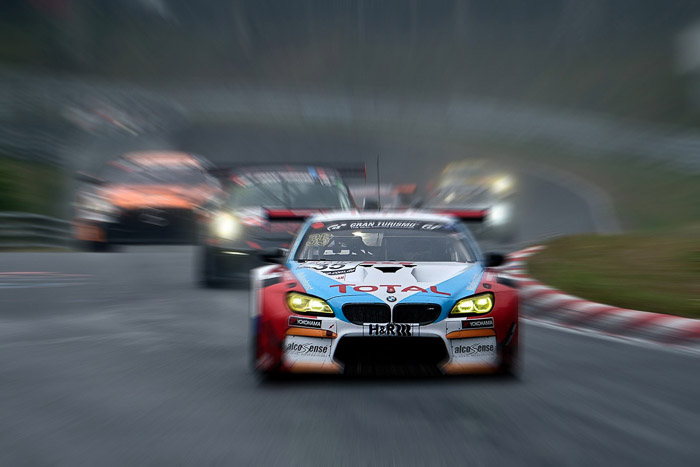 Photo of racing cars with radial blur effect