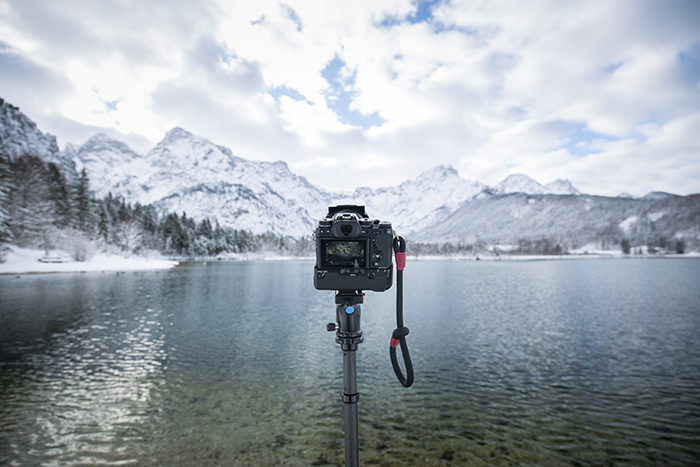 Photo of a camera on a monopod in front of a lake