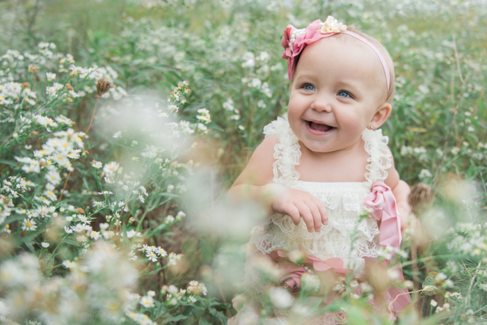 Photo of a little girl on a field of flowers