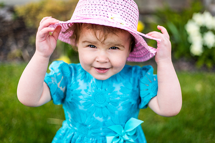 Photo of a little girl in a pink hat