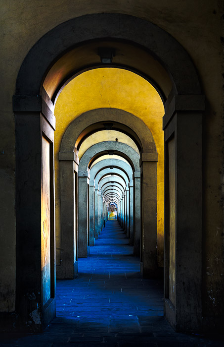 A long hallway in the interior of a grand building