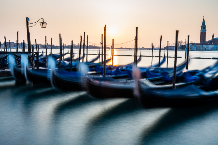 A line of blurry gondolas