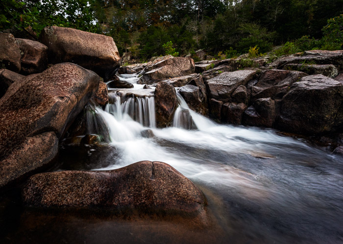 A small waterfall flowing over rocks
