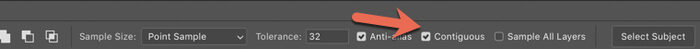 A red arrow pointing to the Contiguous selection on Photoshop options bar