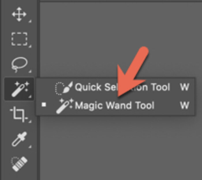 A red arrow pointing to the magic wand selection tool on Photoshop options bar
