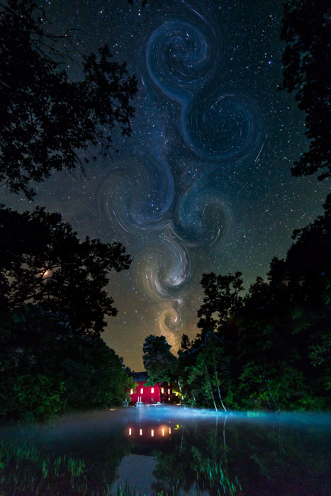 Photo of a river with the starry night sky above with abstract effect