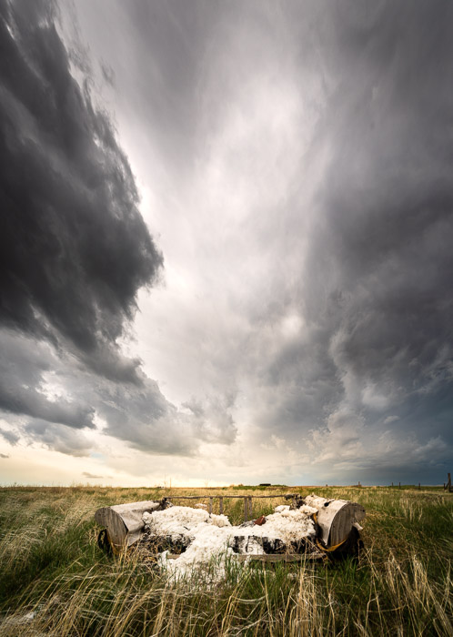 A vertical, 4-image panorama of storm clouds in the American Midwest