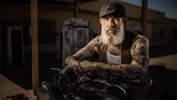 Portrait photo of a guy on a motorbike
