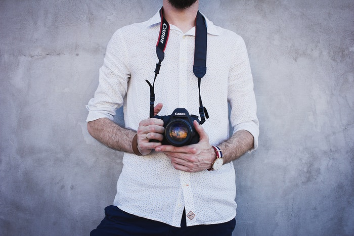 Photo of a guy holding a camera
