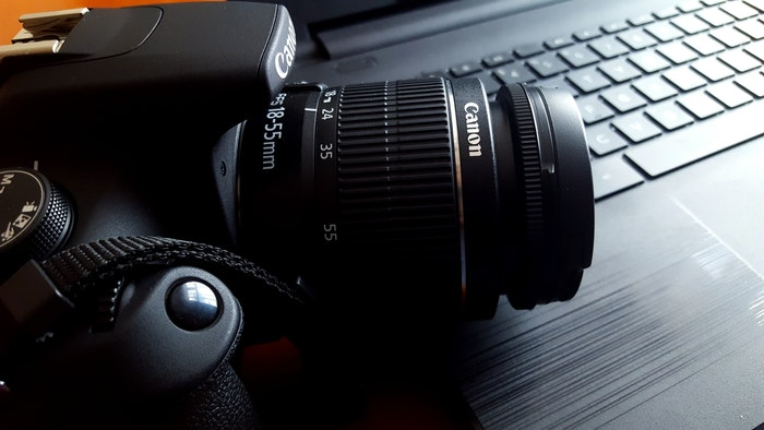 A Canon DSLR camera on a desk