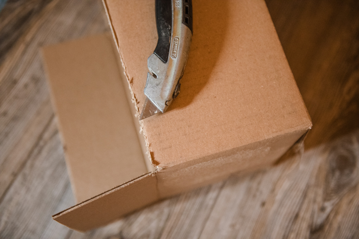 Removing the top of a cardboard box to make a softbox