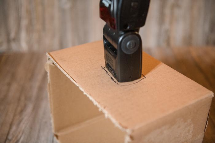 Cutting a cardboard box to make a softbox