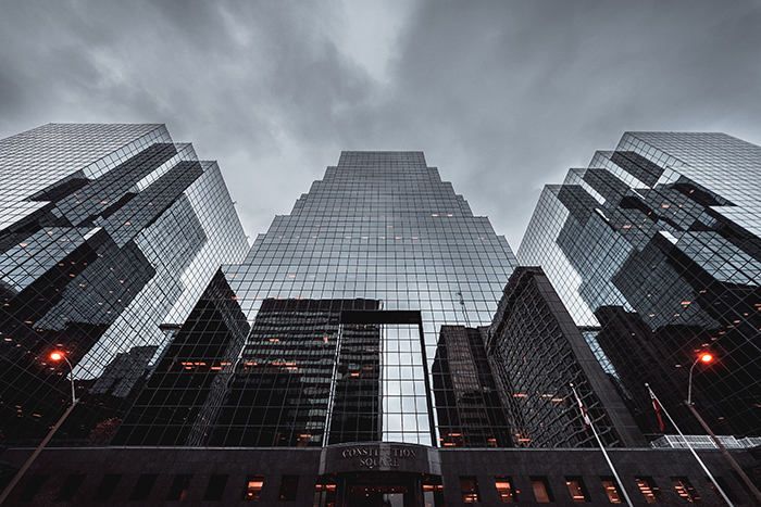 low angle view of multi-windowed skyscrapers