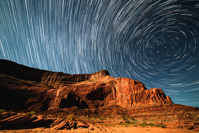Mountainous landscape with impressive star trails in the sky