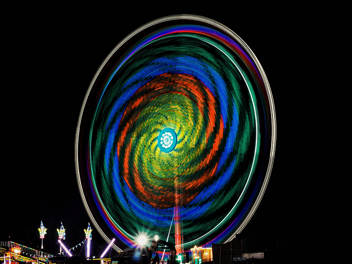 a colorful ferris wheel at night