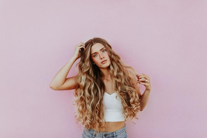 Portrait photo of a girl with long curly hair