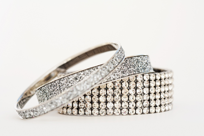 3 silver bracelets with a lot of stones on white background
