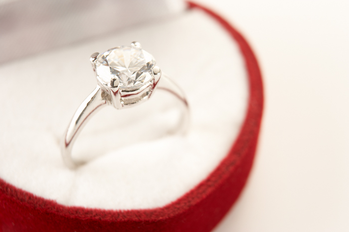 white gold and diamond ring in a red box