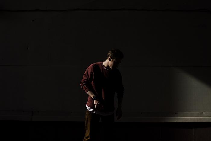 Shadowy portrait of a man in a dark room